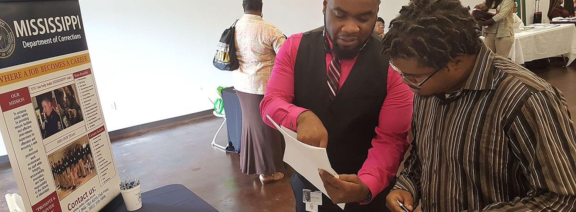 Job fair participant learning about MDOC